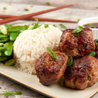 Pork Shumai Meatballs with ponzu dipping sauce, sugar snap peas, and rice