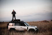 Ross Holgate surveys the terrain from the roof of his 2020 Land Rover Defender.