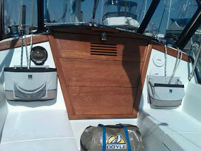 Photo: 2011 companionway boards refinished, frame of companionway boards replaced, instument covers, sheet organizers and newer dodger