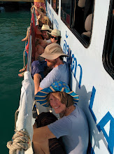 Photo: The family squeezes into a hot, over-crowded ferry for the ride back to Koh Lanta