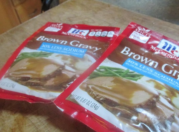 Add the brown gravy packets and spices as desired, stir to blend together.