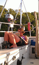 Photo: Anne relaxing at anchor in Snake Creek