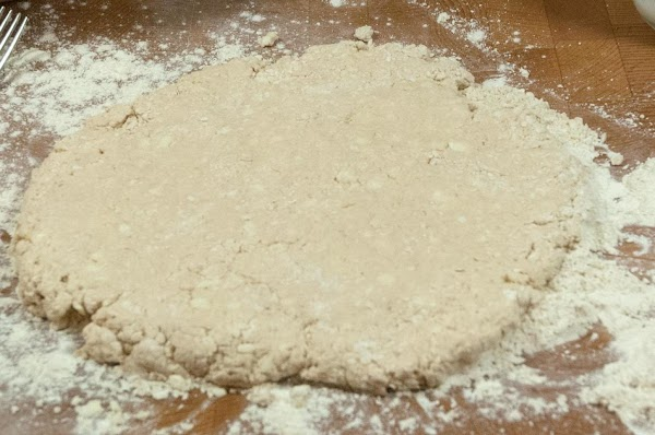 Dust a clean surface with some flour, and knead the dough until elastic, and...