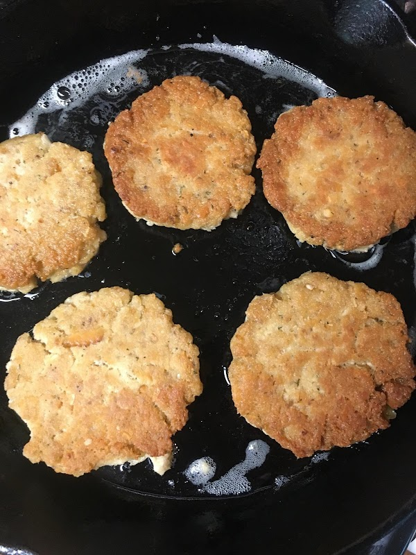 Once you have the patties prepared, place each one carefully into the skillet and...