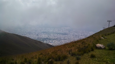 Photo: Day 1: This was the arial view from the Pichincha Mountain. It was cloudy so the view was not ideal, but the clouds broke long enough to attempt to get this picture of the city of Quito below.