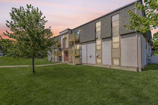 Thunderbird apartment building with light exterior at dusk