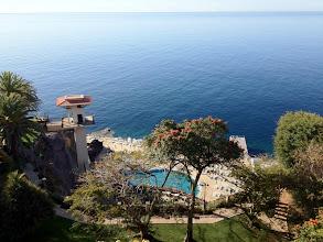 Photo: Näkymä parvekkeeltamme uima-altaille ja merelle