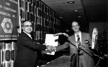 Photo: Regional Chair George Menzies congratulates Grant Wilson (pr 1976-77) on receiving 4th consecutive Chapter Award of Excellence