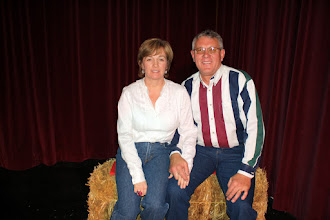 Photo: Russ McDonald and his bride holding hands on the hay bale