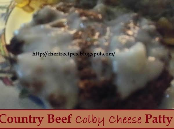 Ground Chuck Burger With Colby Cheese And Spices Mixed In