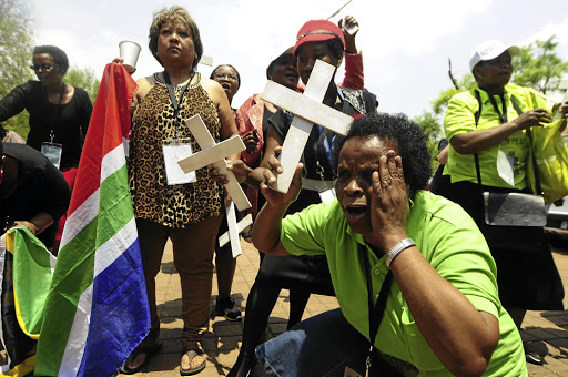 Family members of dead Esidimeni patients protest outside the venue of the hearings in Parktown. The writer says the ANC must punish government workers involved in causing the tragedy. /Thulani Mbele