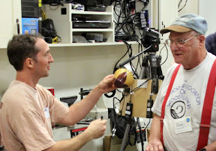 Photo: Bob Grudberg (right) presents a lucky Matt Radtke with the much-coveted, open-segmented bowl he won from Bob in the monthly Bring-back Challenge.