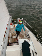 Photo: Anne at the helm as we approach South Bass Island, OH