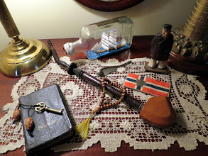 Photo: This pipe belonged to my maternal great grandfather. Torger Osmundsen. The Psalm book, Julen Sanger book and worry beads were items my grandfather Oscar Osmundsen brought with him from Norway.