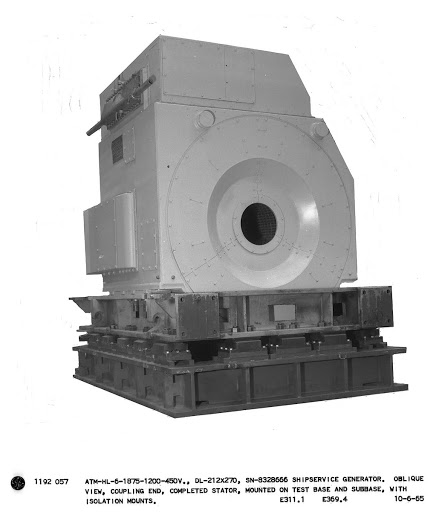 ATM-HL-6-1875-1200-450V., DL-212x270, SN-8328666 ship service generator. Oblique view, coupling end, completed stator, mounted on test base and sub-base, with isolation mounts.