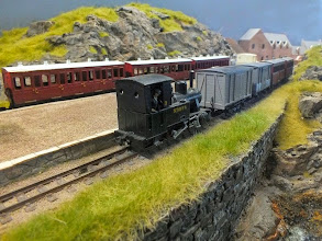 Photo: 008 Isle Ornsay is a DCC layout, and here we see Tom Dauben's converted Roco 0-6-0 Staffa arriving with a branch mixed train whilst the passenger service waits for the arrival of the ferry from Mallaig on the other platform .