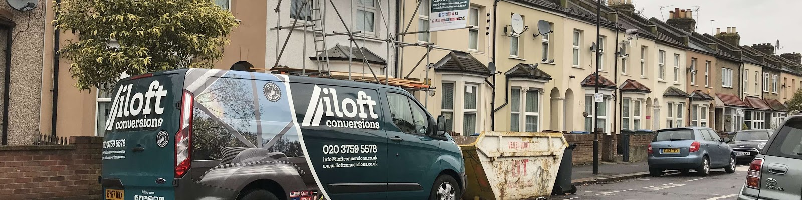 the iloft conversion van standing outside of a loft conversion in progress
