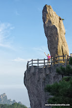 Photo: 飞来石 Flying Over Rock stands 13 m (42 ft) tall and is 8 m (26 ft) wide. It looks like it fell from heaven and perched on a ledge.