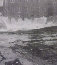 Photo: Water up to 10 feet high in some places smashed mercilessly against buildings, such as the Gilbert Clock Building Two shown here.