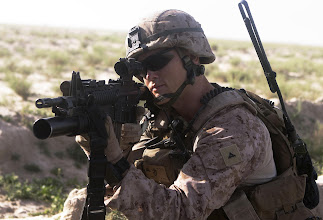Photo: GARMSIR DISTRICT, Helmand province, Afghanistan - Lance Cpl. Shawn Cole, a Cresskill, N.J., native, provides security during a security patrol, April 30. Cole, an assistant patrol leader of the 1st Battalion, 3rd Marine Regiment Guard Force Platoon, patrols regularly as part of guard force's security responsibilities of the area. A Female Engagement Team was with the patrol and stopped at a local school. The FET's purpose is to interact with the female population in the local community and find the needs of the women in the area. The battalion supports Regimental Combat Team 1, the Marine ground combat element in Southern Helmand province.  The mission of the RCT is to partner with Government of the Republic of Afghanistan to conduct counterinsurgency operations to secure the Afghan people, defeat insurgent forces, and enable Afghanistan to assume security responsibilities in the region. Ultimately, the partnered forces promote the expansion of stability, development and legitimate governance.