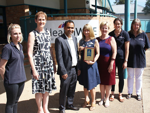 HealthWISE New England North West chief executive Fiona Strang with the Healthy Town Challenge award, pictured here with primary care nurse Chloe Orman, integrated care manager Anne Williams,  the Office of Preventative Health's Santosh Khanal, the Heart Foundation's Julie Anne Mitchell, HealthWISE dietitian Rachael Smalley and primary care nurse Fiona Robertson.
