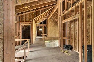 Photo: stairs to the left, then attic for furnace and elevator shaft to the left next to the stairs.