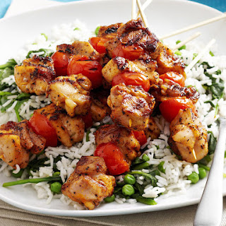 Cajun Chicken Skewers with Spinach, Peas, and Rice.