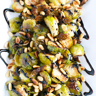 Roasted Brussels Sprouts with Toasted Pine Nuts and Balsamic Glaze.