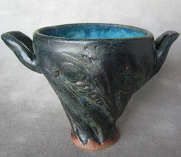 Photo: small cup with two ear shaped handles 10 of 10.