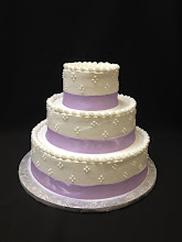 Photo: Simple wedding cake: smooth whipped cream frosting w/4-dot clusters around sides & lavender ribbon wrap around bottoms. Traditional top borders.