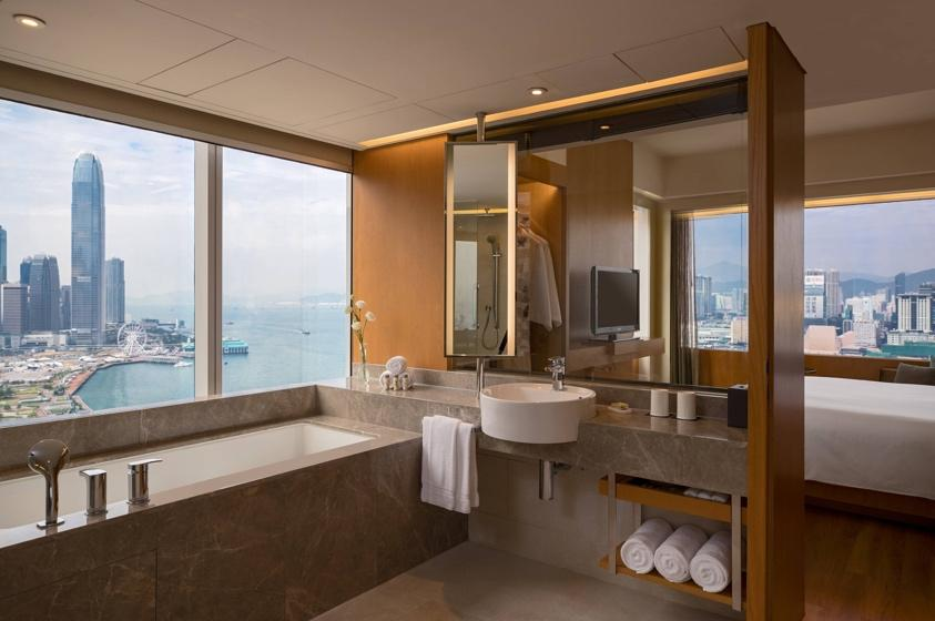 A Bathroom With A Large Window  Description Automatically Generated With Medium Confidence