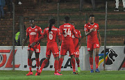 Mothobi Mvala (R) celebrates with teammates after scoring the opening goal.
