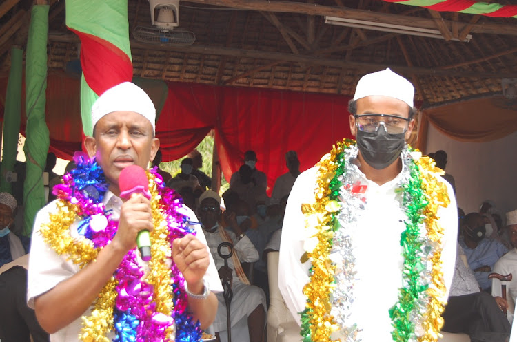 Garissa governor Ali Korane and Yusuf Haji's son Abdikadir Mohamed./STEPHEN ASTARIKO