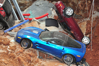 """Photo: The first three Corvettes to be removed from the sinkhole will be the 1962 Corvette, the 1993 40th Anniversary """"Ruby Red"""" Corvette, and the 2009 """"Blue Devil"""" ZR1"""