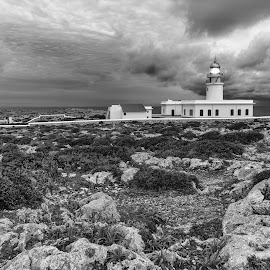 Cavalleria Lighthouse in Menorca. by Liam Coburn Dunne - Black & White Buildings & Architecture ( nikon d800, black & white, menorca 2016, white, lighthouse, moody, cavalleria, light, rocks )