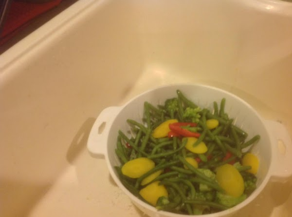 Blanch the frozen vegetables in a large skillet or pan of boiling salted water...