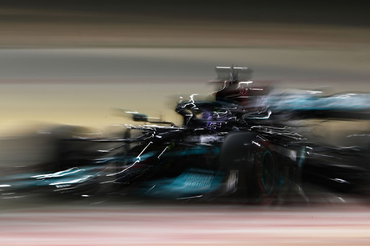 Lewis Hamilton of Great Britain driving the (44) Mercedes AMG Petronas F1 Team Mercedes W12 on track during Day Three of F1 Testing at Bahrain International Circuit on March 14, 2021 in Bahrain, Bahrain.
