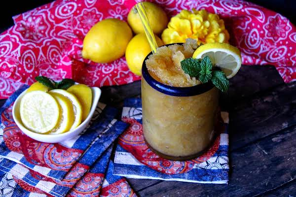 Frozen Bourbon Slush In A Glass With Mint And Lemon.