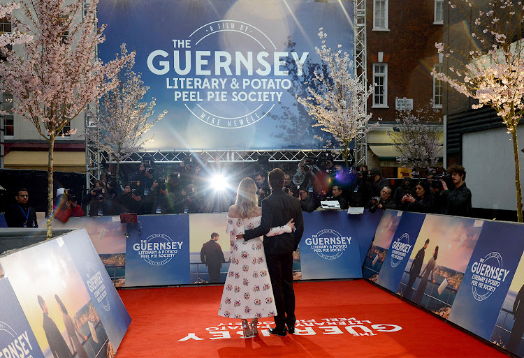 Lead actors Lily James (L) and Michiel Huisman attend 'The Guernsey Literary And Potato Peel Pie Society' World Premiere at The Curzon Mayfair