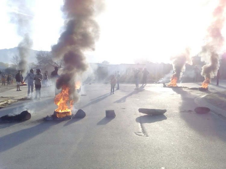 Protesters burn tyres in Pelem Street, Mlungisi, as part of service delivery protests in the Enoch Mgijima Local Municipality.