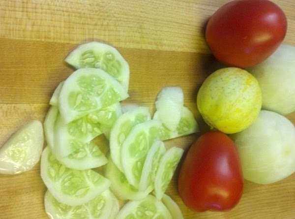peel and slice cucumbers, seed and dice tomato's