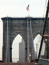 Photo: Final view of the eastern tower of the Brooklyn Bridge topped by Old Glory.