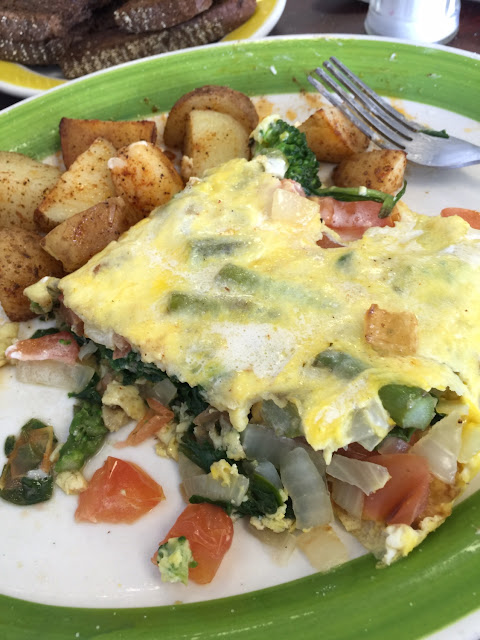 Half of the very loaded vegetable omelette-substituting extra onions for mushrooms