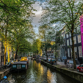 Waterway in Amsterdam by Hariharan Venkatakrishnan - City,  Street & Park  Neighborhoods ( #sunset #amsterdam #waterway #sunandshade #serene,  )