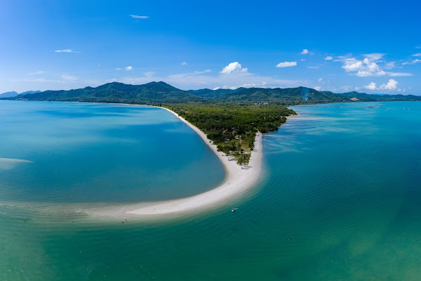Swim at Laem Haad Beach on the north-eastern coast of Koh Yao Yai