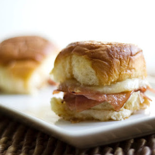 Hot and Melty Oven Baked Ham and Swiss Sandwiches.