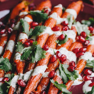Roasted Carrots with Green Tahini Sauce and Pomegranate.
