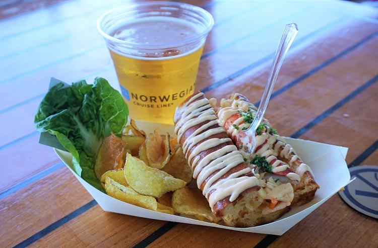 A lobster roll with chunks of lobster in a mustard dressing in Ocean Blue.