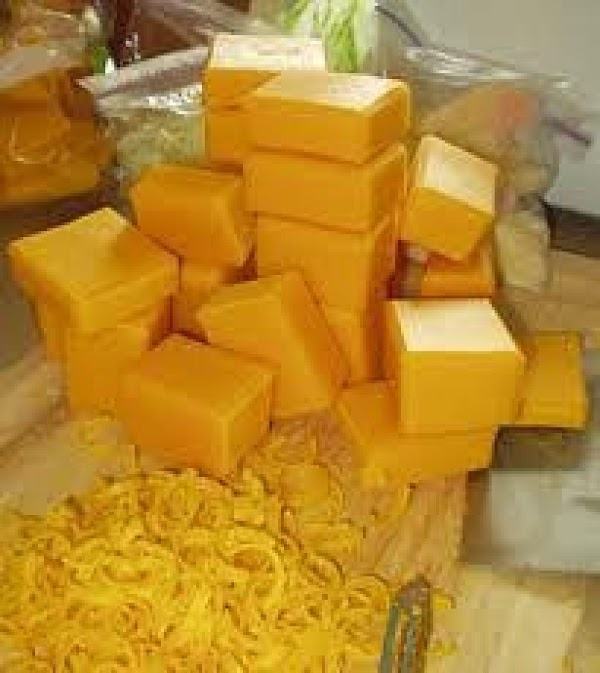 While water is heating and noodles are cooking, cut up the blocks of cheese....