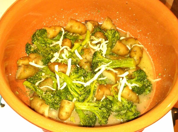 And broccoli to baking dish.  Pour in butter mixture and stir.  Sprinkle...